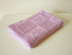 """Lovely baby blanket """"Charlotte"""" pattern with little hearts. This blanket is reversible as it is knitted in knit and in purl stitches.Made by you and with love - it will be a perfect gift to your friends' baby!The sample was knit in Drops Merino Extra Fine. A substitute yarn is shown below."""