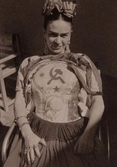 Frida Kahlo with her body cast and her love for symbol of the communist party in Mexico.