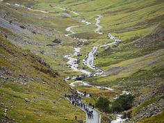 The peloton ride up Honister Pass during stage two of the 2013 Tour of Britain from Carlisle to Kendal.