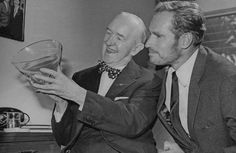 Stan Laurel and Charlton Heston