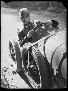 A young woman driving a sports car, photograph by André Kertész, 1928.