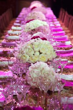 The juxtaposition of hot pink dinner menus with crisp, white peonies is fabulous for the modern bride.