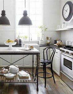 white kitchen with wood floors and black/iron  elements