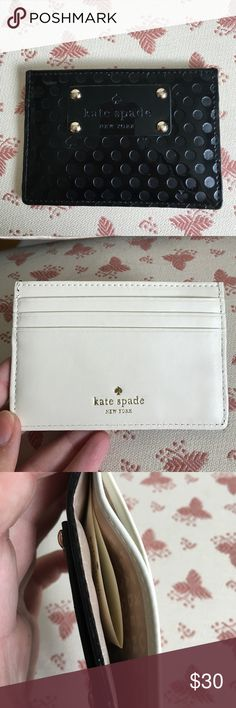 Kate Spade credit card holder! New Kate Spade credit card holder. Black patent with embossed dots and spades. Reverse side is white leather. 4 card slots on the side and one bigger slot in the middle. Excellent condition! Measures about 4.5 inches across and 3 inches from top to bottom kate spade Bags Wallets
