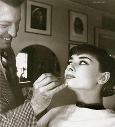 Audrey Hepburn in the makeup chair.