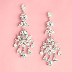 OLD HOLLYWOOD CHANDELIER EARRINGS  These silvertone chandelier earrings feature a glamorous selection of round brilliant cut, marquise and pear cut cubic zirconias, arranged into a charming setting perfect for a romantic or vintage inspired look. Each earring features 18 gems, each hand set into a prong setting. Truly beautiful quality and amazing sparkle!