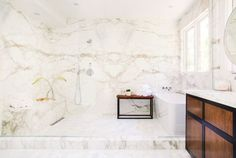 All marble bathroom with wood cabinets and large bathtub  | RECOVETD #summer #vibes #currentlycoveting