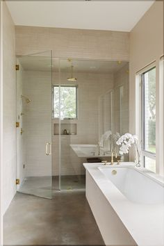 Just like the rest of the renovated house, the master bath is airy and serene. It features a custom limestone bathtub and plumbing fixtures from Newport Brass.