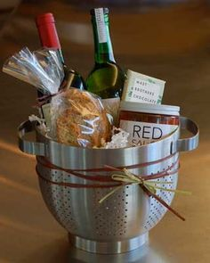 Housewarming Spagetti Dinner Gift ~ in a stainless-steel Ikea colander with noodles, sauce, bread, wine, cheese, chocolate Bucket, Barware, Ice, Gift Ideas, Gifts, Presents, Buckets, Homemade Ice, Gift Guide