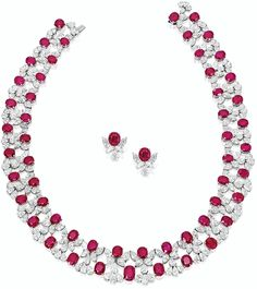 RUBY AND DIAMOND NECKLACE AND PAIR OF MATCHING EARRINGS.        The necklace composed of fifty-four graduated oval rubies together weighing 76.70 carats, decorated by pear-shaped diamonds together weighing approximately 63.10 carats, length approximately 380mm; and pair of matching earrings, each centring on an oval ruby weighing 2.17 and 2.22 carats respectively, the diamonds altogether weighing approximately 3.85 carats; mounted in platinum.  Sotheby's.