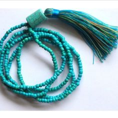 """Aqua turquoise beaded tassel necklace Turquoise aqua nylon tassel necklace gorgeous mixed colors green, blue, golden, turquoise. 4mm beads. Length to fit all 20"""" Brina Box Jewelry Necklaces"""