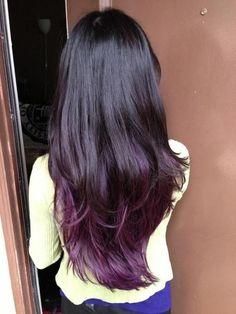 Dark brown/ almost black hair with dark purple tips.