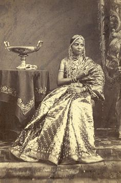 Portrait of a seated girl wearing jewellery, from Madras in Tamil Nadu, taken in 1872 - Old Indian Photos