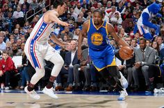 Kevin Durant of the Golden State Warriors handles the ball during a game against the Philadelphia 76ers on February 27 2017 at the Wells Fargo Center...