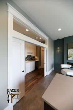 It's an open and shut case; green is the gateway color, easy to live with and instantly soothing. A transom tops this beautiful passageway with doors that can be pocketed away or pulled closed. Basement Walls, Pocket Doors, Interior Doors, Small Spaces, Garage Doors, Woodworking, Live, Outdoor Decor, Green