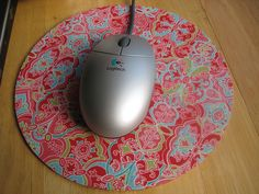 custom mouse pad.    The same idea could easily be applied to cork backed coasters. Or elevate the idea into functional art. Pop cork backed fabric into flea market frames spray painted to coordinate with your fabric. Hang en masse anywhere you need to pin up notes, pieces of inspiration, or add a shot of color.