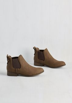 Downtown for the Day Bootie in Brown. From the sculpture gallery to the bistro, you look everyday chic in these brown booties by Madden Girl. #tan #modcloth
