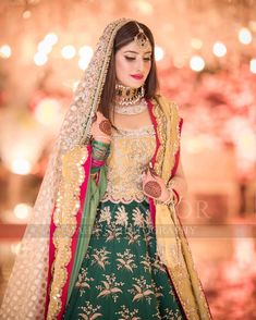 Image may contain: 1 person, standing Bridal Mehndi Dresses, Muslim Wedding Dresses, Bridal Dress Design, Bridal Outfits, Bridal Style, Designer Bridal Lehenga, Bridal Lehenga Choli, Asian Wedding Dress Pakistani, Pakistani Suits