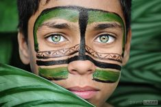 This photo features the green eyes of a boy from Sao Paulo, Brazil, who is wearing face paint applied during an activity at a cultural centre for street kids called Beija Flor (Hummingbird; literally, Flower-Kisser). David Lazar / Via davidlazarphoto.com