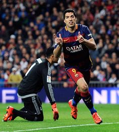 Luis Suarez of FC Barcelona celebrates after scoring his team's 4th goal during the La Liga match between Real Madrid and Barcelona at Estadio Santiago Bernabeu on November 21, 2015 in Madrid, Spain.