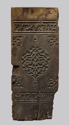 Panel from a Torah Shrine- ca. 1040. Cairo, Egypt. Wood (walnut) with traces of paint and gilt. 34 3/8 x 14 7/16 x 1 in. (87.3 x 36.7 x 2.5 cm). The Walters Art Museum and Yeshiva University Museum (64.181)