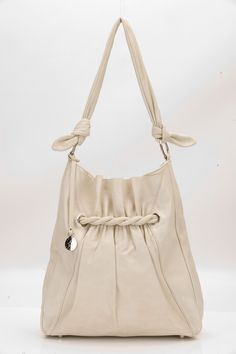 This stylish oversized tote bag has soft gathered detail on the front panel, which contrasts to geometric seams both front and back.    Handcrafted in super soft calf leather, the unstructured shape of this bag drapes beautifully and is comfortable worn on the shoulder.