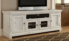 Shabby chic entertainment console with a weathered white washed finish