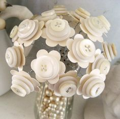 Button Bouquet ~ Vintage inspired handmade flowers in bead filled vintage salt shaker.    Sweet shabby shabby cottage chic button bouquet ~ lovely decor for your home or office!    19 hand twisted button flowers are placed in a vintage salt shaker filled with gorgeous perfectly aged vintage beads. These beads came from an old necklace that was well loved & worn often. Shaker measures 2 (5.1 cm) wide at base & 4 1/2 (11.4 cm) tall. Flowers are made from stardream cardstock punchie...
