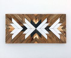 This piece is made to order. Lead time for shipping is 1 week. The photo shown is a previously sold beautiful modern art piece made with reclaimed wood. Its made with pallet and reclaimed wood It can be hanged vertically or horizontally. We used 2 different wood stains and painted a few pieces with white paint. This piece would add a modern look anywhere in your home! We can make this same piece with different sizes and colors as well, please contact us for more information! Sizes: 12X24…
