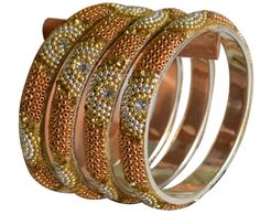 Lac Bangles studded with Gold, Silver beads & Gold & Silver Crystals. Match It on any Festive Ethinic wear1 unit= 1 pairPlease refer the size chart for size description.