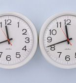 """Felix Gonzalez-Torres. """"Untitled"""" (Perfect Lovers), 1991, Clocks, paint on wall, 14 x 28 x 2 3/4 inches.  MOMA Collection"""