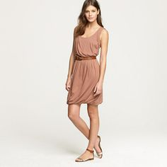 We love the just-right drape of this chic silhouette—it skims the curves and creates a wonderful slimming effect. Add a statement belt and leg-lengthening wedges and watch heads turn. Rayon/spandex. Sleeveless. Straight skirt. Elastic waistband. Bubble hem. Falls to knee. Import. Machine wash.
