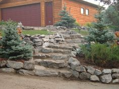 These garden stairs keeps with the rock  alpine theme.  A beautiful addition with its irregular steps curving up the slope. Lakeside Cottages by Creative Landscape  Design