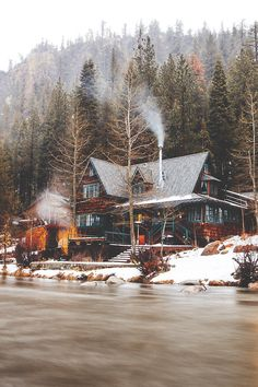 Cabin at Lake Tahoe, California. Love the rustic wintry feel of this picture with the smoke in the chimney, shingled cabin exterior with green trim, pine forest in the background and blanket of sparkling white snow in front. Haus Am See, Cabin In The Woods, Home In The Mountains, Log Cabin Homes, Log Cabins, Cabins And Cottages, Architecture, My Dream Home, The Great Outdoors
