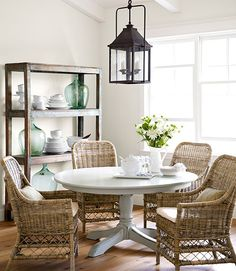 In this California home, fresh paint transformed the dining table, a $100 Craigslist score. The owner bought the wicker chairs and shelving unit, crafted from salvaged elm, at R.J. Imports, a San Juan Capistrano boutique. The table is painted Eucalyptus by Restoration Hardware.   - CountryLiving.com