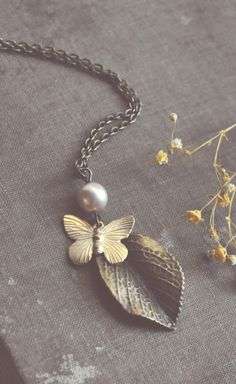pearl and butterfly necklace by bellehibou