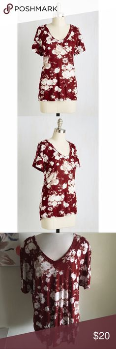 Modcloth tee Why buy a bouquet today? 'Cause beauty is meant to be enjoyed! Same goes for this burgundy top- the fashionable look of its v- neckline, fine ribbing, and khaki and white floral print are a good choice at all times. Size 3x, could also fit 4x. 100% rayon. New without tags. ModCloth Tops Tees - Short Sleeve