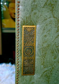 Upholstered door~fashioned after the design of wall-papered doors that were used to help sound-proof rooms in the late 18th century