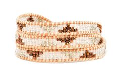 Boho Betty Pattaya bracelet - Thai Zen collection - Discover the mysterious allure of the Far East with silver and metallic brown beads set on an earthy tan leather wrap.  The geometric design mimics a multi-tiered Thai temple, giving it a striking, exotic flair. #LoveBohoBetty #BohoBetty #Fashion #Jewelry
