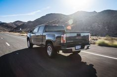 gmc-canyon-v-6-rear-three-quarter-in-motion-2015