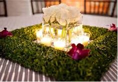Woodsy Wedding Centerpieces - Bing Images only do logs with tea lights instead of the shrubs