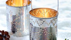 Homemade christmas lanterns !    Use tins cans, wash them out and remove label. Fill up with water and freeze, put towel underneath the tin can and use a screwdriver and hammer to make holes.    Tip - draw your pattern onto paper and blue-tak to tin can to get a perfect design!