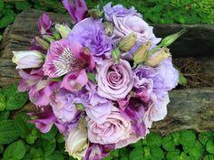 Wedding bouquet Lisianthus, roses, astromelias purple an soft pink