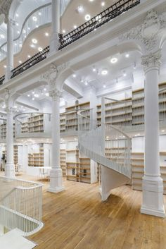 Monochrome Bookstore  Just renovated in Bucharest, Romania, this six-story Carousel of Light houses 10,000 books for sale. The building's 19th Century facade and interior were painstakingly restored with an art gallery on the first floor and a cafe on the top floor.