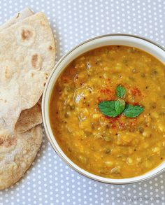 Fragrant aroma of indian spices in Dal. Ingredients 1 cup (210g) red lentils, rinsed well 3cm fresh ginger, sliced 2 bay leaves 1 cinnamon stick 2 tbs (40g) butter 1 large onion, finely chopped 2 cloves garlic, crushed 2 tsp turmeric 1 tsp cumin 1/2 tsp garam marsala 1/2 tsp chilli flakes 2 tbs lemon juice 1/2-1 tsp salt 1 tbs chopped coriander leaves Naan bread or pappadums, to serve