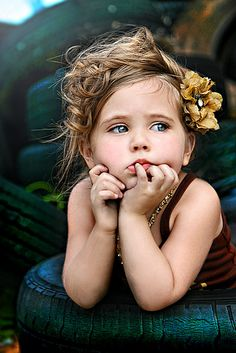 precious.... Love the color and background, the disheveled upstyle and expression are perfect. Stinking adorable. She is dressed up but doesn't look like a Pageant Girl.
