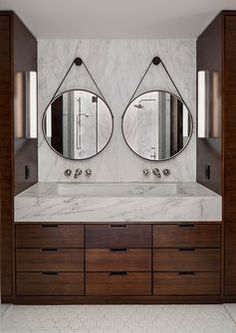 Love this vanity and faucets out of wall...not a marble sink/counter, prefer concrete, sandblasted black granite or soapstone...something that is harder to stain.