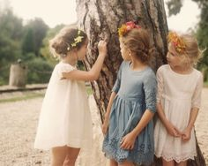 little girls in eyelet dresses and floral crowns