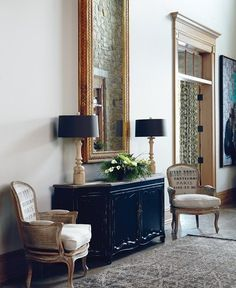 This foyer contains the perfect design elements:  Chest  Chairs  Mirror  Lamps  Fresh Flowers  Area Rug