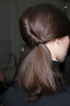rolling-pin pony: create low side part, & divide hair into 2 sections; sweep 1 section across forehead & secure it in low ponytail at nape; fold 2nd section into reverse French pleat, rolling down toward ponytail; merge roll w/ ponytail & secure w/ hair elastic
